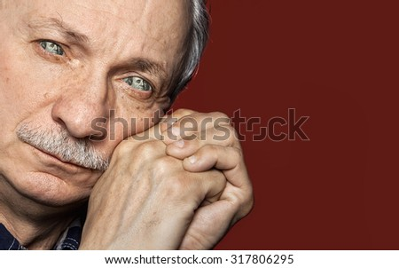 Avarice and greed concept. Humorous portrait of an elderly man with portrait of the president from one hundred dollar bill instead of the eyes - stock photo