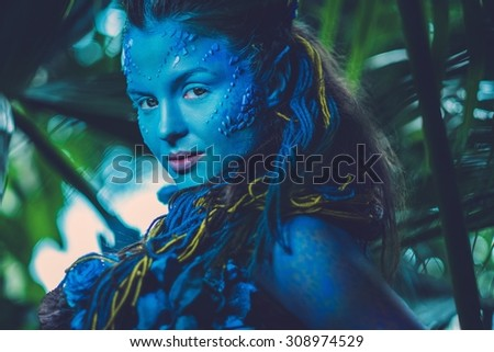 Avatar woman in a magical forest - stock photo