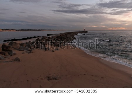 Ave river mouth at dusk, almost night, with interesting colorful cloudy sky. Vila do Conde, north of Portugal. - stock photo