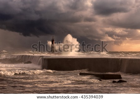 Ave river mouth, north of Portugal, during a storm at sunset. Enhanced sky. - stock photo