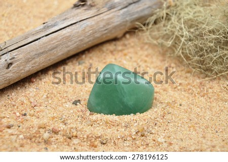Aventurin on beach - stock photo
