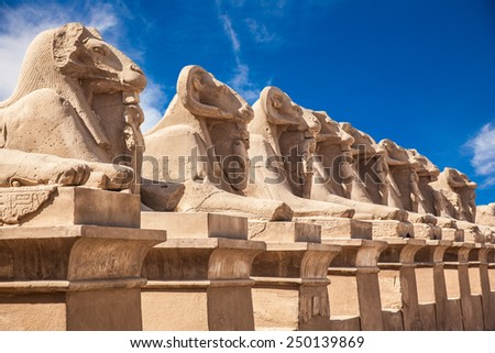 Avenue of the ram-headed Sphinxes. Karnak Temple. Luxor, Egypt - stock photo