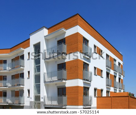 Average contemporary apartment building . Generic residential architecture. - stock photo