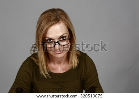 average real woman peering over glasses