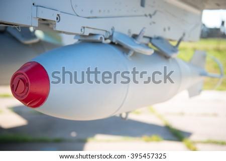 aviation bombs on a military bomber closeup - stock photo