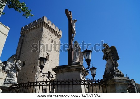 AVIGNON, FRANCE - CIRCA JUNE 2015: Palace of the Popes in Avignon, AVIGNON, FRANCE - CIRCA JUNE 2015: Palace of the Popes in Avignon, Jesus Christ on the cross
