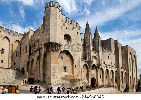 AVIGNON, FRANCE - 1 JULY 2014: Pope palace in Avignon which became the residence of the Popes in 1309. Palace occupies an area of 2.6 acres. July 1, 2014 Avignon. - stock photo