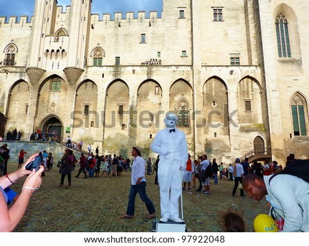 AVIGNON, FRANCE - JULY 17: Unidentified mime perform in Pope palace square during Avignon Theater Festival which in July 2011 was attended by 450 theater companies in Avignon, France on July, 17, 2011 - stock photo