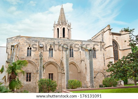 AVIGNON, FRANCE - MAY 5, 2013: The  medieval Temple of Saint Martial is surrounded by cozy garden, located in the old town on Agricole Perdileur street, on May 5 in Avignon.