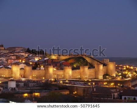 Avila city, Spain. UNESCO monument at dusk - stock photo