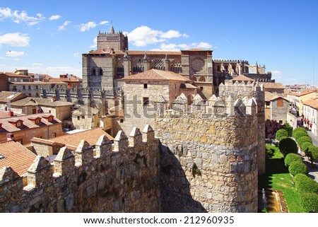 AVILA, SPAIN - JUNE 08, 2014: Avila Cathedral from old fortress wall. It was planned as a cathedral-fortress, its apse being one of the turrets of the city walls.                        - stock photo