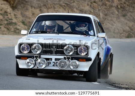 AVILA, SPAIN - MAR 9 : Scottish driver Callum Guy and his codriver Fred Bell in a Ford Escort RS MkII race in the IV Historic Rally of Spain, on Mar 9, 2012 in Avila, Spain - stock photo