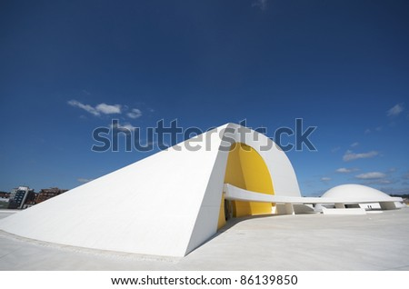 AVILES, SPAIN -  AUGUST 10: Niemeyer Center on August 10, 2011 in Aviles. designed by Oscar Niemeyer, the Niemeyer Center offers a program dedicated to the most diverse art and cultural events. - stock photo