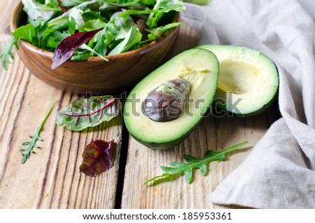 Avocado and salad mix - stock photo