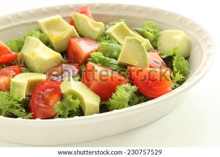 avocado and wasabina salad - stock photo