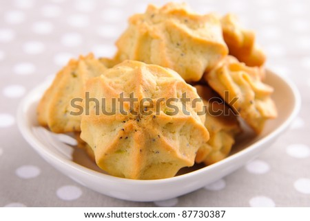 Avocado cookies with poppy seeds in a small plate - stock photo