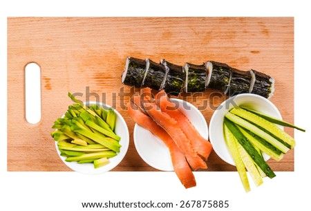 avocado, cucumber, fish and fresh rolls on a wooden board - stock photo