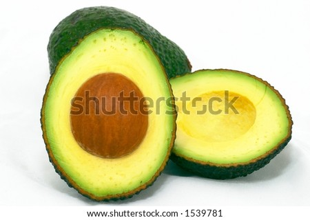 Avocado, cut and whole, isolated white background - stock photo