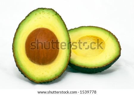 Avocado cut, isolated white background - stock photo