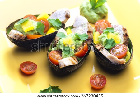 avocado filled with chicken salad and avocado dip - stock photo