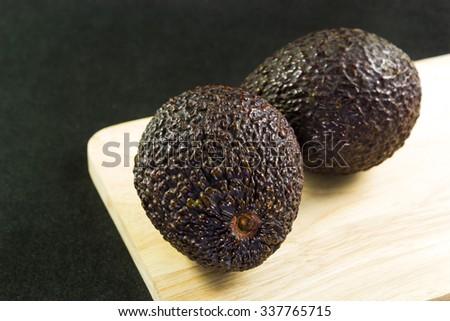 avocado in black background - stock photo