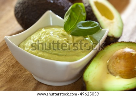 Avocado mousse with halved avocados - stock photo