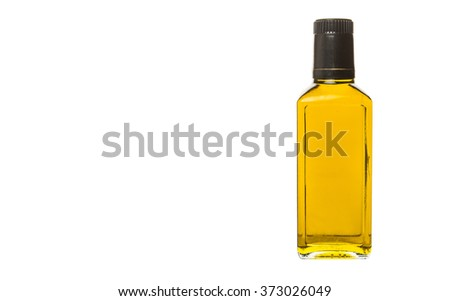 Avocado oil in a bottle over white background - stock photo