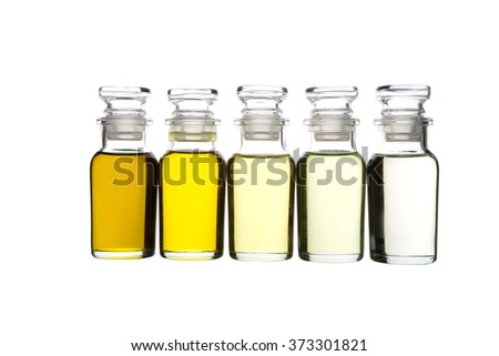 Avocado oil, olive oil, sesame seed oil, grape seed oil and corn oil in glass vial over white background