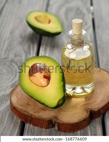 avocado oil on a gray background - stock photo
