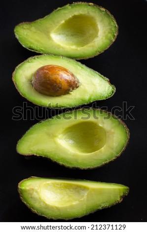 avocado on a black background - stock photo
