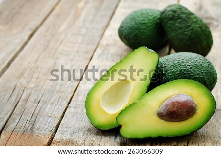 avocado on a dark wood background. tinting. selective focus - stock photo