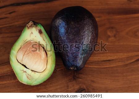Avocado. Organic Avocados on a wooden table. Healthy Vegan food  - stock photo