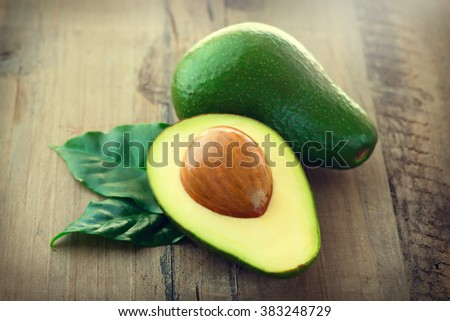 Avocado. Organic Avocados with leaves on a wooden table. Healthy Vegan food concept. Diet. Dieting - stock photo