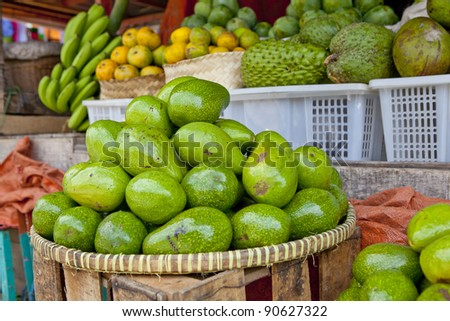 Avocado's in basket in outdoor market, southeast Asia - stock photo