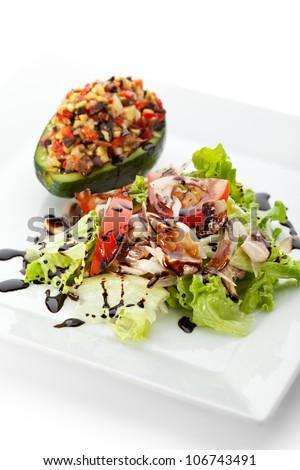 Avocado Salad - Mix of Salad Leaf, Stuffed Avocado, Paprika, Mushrooms, Balsamic Sauce - stock photo