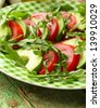 avocado salad with arugula, tomato and olive oil - stock photo