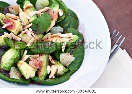 Avocado Salad with baby spinach and a raspberry vinaigrette.