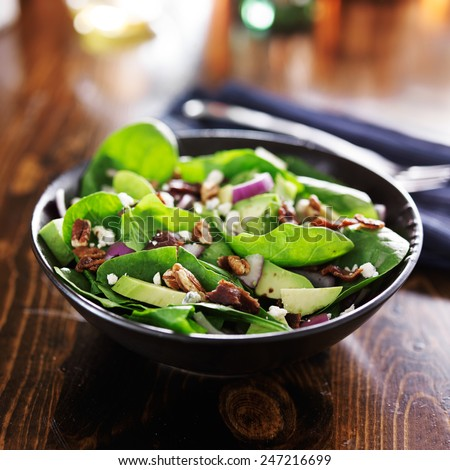 avocado spinach salad with feta cheese, pecans and bacon - stock photo
