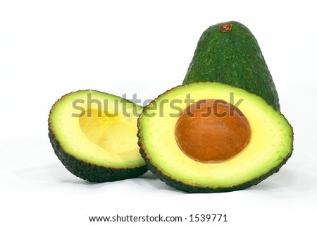 Avocado whole and cut, Green on it's side, isolated white background - stock photo