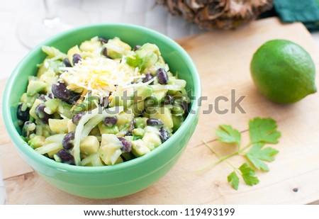 Avocados, black beans and pineapple salad horizontal - stock photo