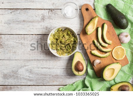 Avocados on a wooden table