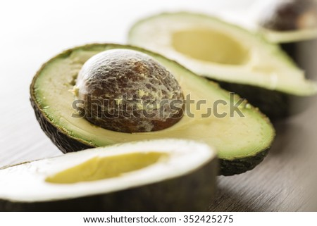 Avocados on a wooden table. Healthy Vegan food concept. Diet. Dieting - stock photo