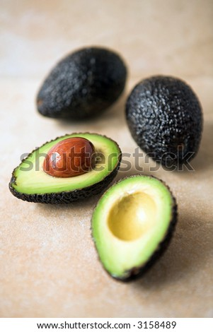 Avocados sliced & whole ready for the chef - left full size to enable cropping if desired - shallow dof