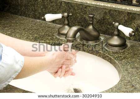 avoid germs by always cleaning your hands - stock photo