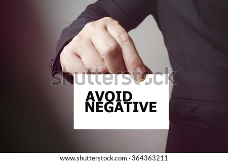AVOID NEGATIVE paper on the card , business concept , business idea - stock photo