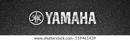 AVOLA, IT - 18 JANUARY, 2017: Yamaha text logo on dark background. Yamaha Corporation is a Japanese multinational corporation that products musical instruments, electronics and motorcycles.