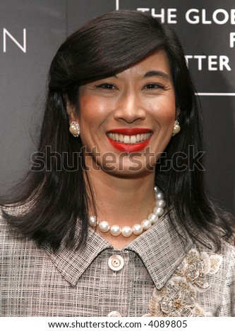 Avon Products chairman and CEO Andrea Jung attends a reception following the Global Summit For A Better Tomorrow at the United Nations on March 7, 2007 in New York City. - stock photo