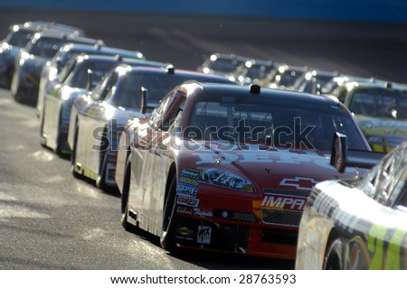 AVONDALE, AZ - APRIL 18: Dale Earnhardt Jr. #14 in a line of cars at the start of the NASCAR Sprint Cup race at the Phoenix International Raceway on April 18, 2009 in Avondale, AZ. - stock photo