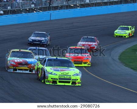 AVONDALE, AZ - APRIL 18: Jeff Gordon (24) fighting among the lead group during the opening laps of the NASCAR Sprint Cup Series race at PIR April 18, 2009 in Avondale, AZ. - stock photo