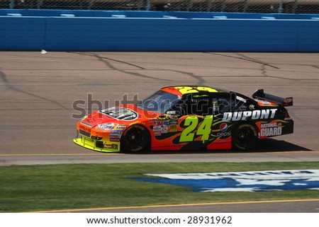 AVONDALE, AZ - APRIL 17: Jeff Gordon in action during one of the practice sessions for the NASCAR Sprint Cup Series race at Phoenix International Raceway April 18, 2009 in Avondale. - stock photo
